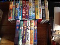 Collection of VHS Disney tapes with a Bush VHS recorder