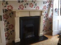 Cream wooden fireplace