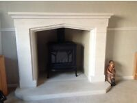 Gas fire and stone surround