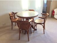Solid wood round dining table with grey marble top and 4 chairs