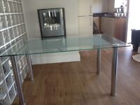 Glass dining table will seat 6