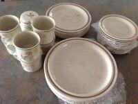Royal Doulton plates, mugs and sugar bowl.