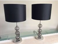 A pair of Matt black/silver base table lamps.
