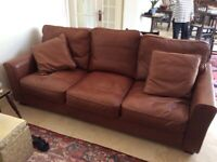 Leather settee and patterned settee