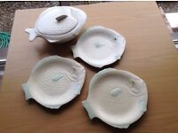 Shorter set of fish plates and tureen