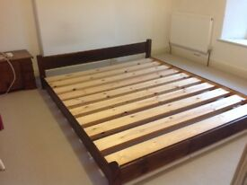 7ft x 6ft Warren Evans dark wooden bed with slatted base