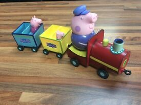 Peppa Pig Train with Grandpa. Removable Peppa and George figures. Train plays tunes and voices
