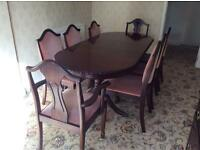 Dark mahogany dining room suite.