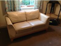 Cream leather 2 seater sofa good condition.