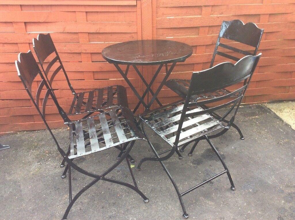 Garden Furniture Gumtree black metal garden furniture set. table and four chairs. fold away