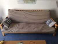 Large futon sofa bed, with sturdy frame and mattress.