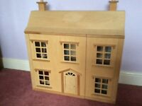 Wooden dolls house complete with figures and furniture