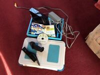 Wii console plus balance board rarely used