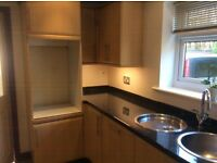 Kitchen units with Hob hood sink and tap, beech doors and black work tops