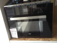Beko intergrated multifunction oven/ microwave. £310 RRP £549. New/graded. 12 month Gtee