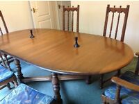 Ercol oak dining table and 6 chairs. Was £4,000 new.