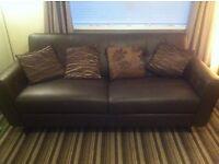 2 three seater brown leather sofas