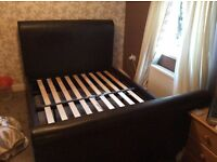Double leather bed in good condition