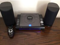 Polaroid CD player with radio lights up blue when on