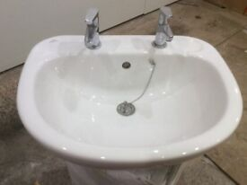 Ceramic bathroom sink basin with taps