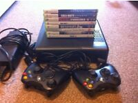 Xbox 360 Slim, 250GB, 2 Controllers + Charger, 13 games| 7 On Disc & 5 On Hard Drive.