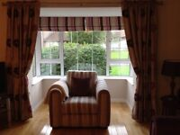 Pair of fully lined long curtains. Excellent condition.