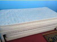 Single bed with trundle under guest bed