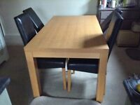 Solid oak dining table and TWO brown leather chairs