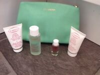 Brand New Clarins Make up Bag with Skin Care Products ALL NEW