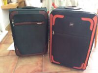 Light weight Suitcases for sale £30 all in good condition, slight scuffing on green case.