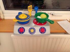 Child's plastic cooker hob with utensils