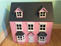Pink doll's house girl toy, with doll's house furniture.