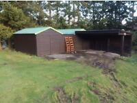 Double garage,timber with metal roof and car port.