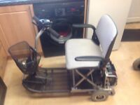 ULTRALITE 355CAR BOOT SIZED MOBILITY SCOOTER IN EXCELENT USED CONDITION , CARRIES 18 STONE 8 MILES