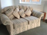Beautiful 2 seater Sofa lovely condition colour cream & green