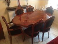 Dining table and chairs all in good condition. Highly polished. 2 Carver Chairs and 4 dining.