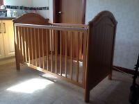 Mamas and Papas solid wood cot-bed and neutral coloured Moses basket with stand.