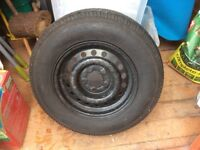 Caravan spare wheel and new tyre