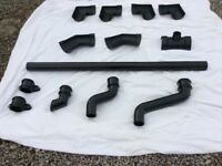 Selection of cast iron guttering and downpipe fittings.