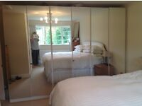Three double mirror fronted wardrobes