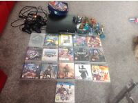 PS3 2 controllers 16 games 16 sky landers and case