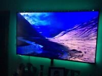 65 inch 4K full hd tv with wall bracket and led lights