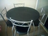 dining table with 4 chair in very good condition . easily dismalted when not in use.