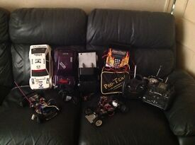 2 radio remote controlled cars + extras