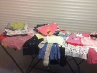 Large bundle of freshly laundered clothes for boys and girls 3 months to 4 years