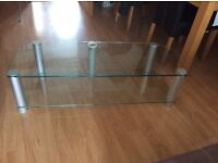 Large clear glass TVs stand