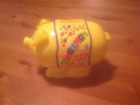 Yellow Plastic Piggy Bank with Shannon on both sides (New with Tags)