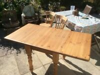 Solid pine drop leaf dining table and 6 pine farmhouse chairs.