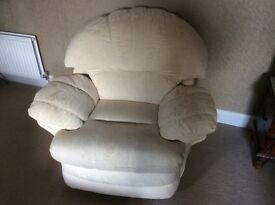 Reclining, swivel arm chair. Very good condition.