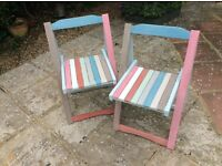 Two fold out candy colour wooden chairs